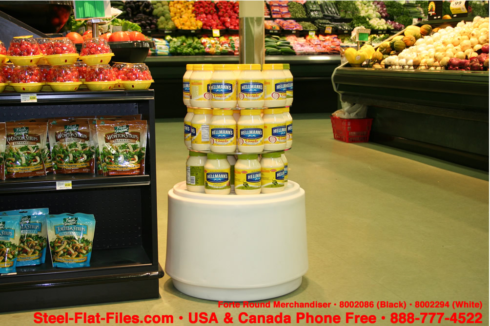 Instant in-store display in white or black. Round and appealing merchandiser.